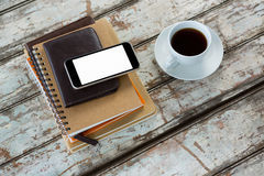Organiser with mobile phone and coffee. On wooden table Royalty Free Stock Images