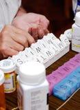 organiserande pillpensionär för ask Royaltyfri Fotografi