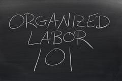 Organiserat arbete 101 på en svart tavla arkivbild