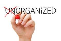 Organiserat inte oorganiserat begrepp royaltyfri bild