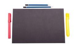Organiserat skrivbord med svart copyspace på vit bakgrund royaltyfria foton