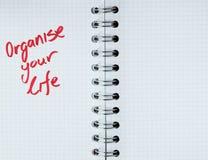 Organisieren Sie Ihre Lebensdauer - Notizbuchanmerkung Lizenzfreies Stockfoto