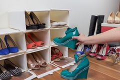 Organising shoes. Organising tidying shoes. spring cleaning stock photos