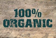100% organisk stämplad text på gammal planka Royaltyfria Bilder