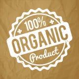 Organisk vit för rubber stämpel för produkt på en skrynklig pappersbruntbakgrund Arkivfoton