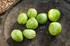 Organiska orientaliska melon på den utomhus- asiatiska marknaden Royaltyfri Foto