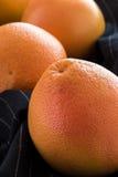 Organiska röda grapefrukter Royaltyfri Fotografi