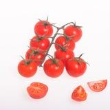 organiska tomater på vit Arkivbilder