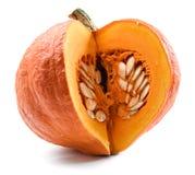 Organiskt moget ljust orange pumpasnitt med frö som isoleras på wh Fotografering för Bildbyråer