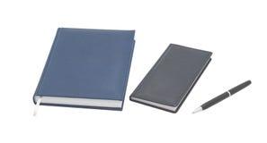 Organizador con la pluma. Fondo blanco. fotografía de archivo libre de regalías