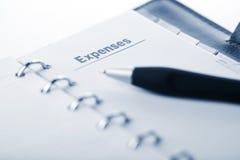 Organizador e pena. página das despesas Imagens de Stock Royalty Free