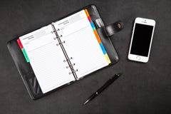 Organizador preto em uma tabela Foto de Stock Royalty Free