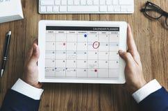 Organizador Urgency de la gestión de la nota del horario de cita del calendario Fotos de archivo