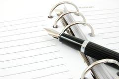 Organizador y pluma del asunto Foto de archivo libre de regalías