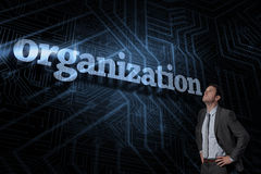 Organization against futuristic black and blue background Royalty Free Stock Image