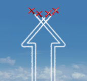 Organization Concept. As an up arrow symbol and icon for success made from an organized group of flying jet airplanes working together at an air show on a blue Stock Photo