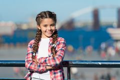 Organize activities for teenagers. Vacation and leisure. What do on holidays. Sunny day walk. Leisure options. Free time. And leisure. Girl cute kid with braids stock photo