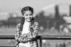 Organize activities for teenagers. Vacation and leisure. What do on holidays. Sunny day walk. Leisure options. Free time. And leisure. Girl cute kid with braids stock photography