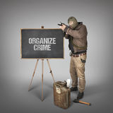 Organize crime text on blackboard with terrorist Royalty Free Stock Photo