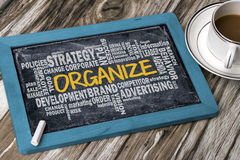 Organize with related business word cloud Stock Photos