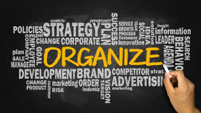 Organize with related business word cloud. Handwritten on blackboard stock photography