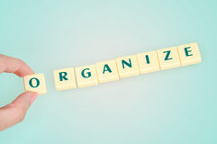 Organize word. On blue background stock photography