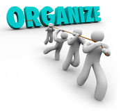 Organize Word Pulled by Team Workers Union Working Together Royalty Free Stock Photo