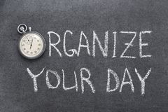 Organize your day. Phrase handwritten on chalkboard with vintage precise stopwatch used instead of O stock photos