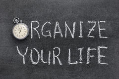 Organize your life. Phrase handwritten on chalkboard with vintage precise stopwatch used instead of O royalty free stock images