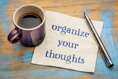 Organize your thoughts. Handwriting on a napkin with a cup of espresso coffee royalty free stock photo