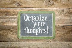 Organize your thoughts. Reminder on a slate blackboard against rustic weathered wood planks royalty free stock photo
