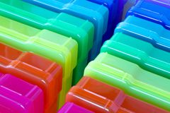 Rainbow boxes for organizing small objects. Organized in color - rainbow plastic boxes in a row for organization Royalty Free Stock Image
