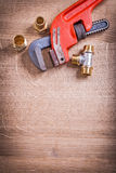 Organized Copysoace Monkey Wrench And Brass Pipe Stock Photo