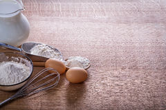 Organized copyspace eggs corolla flour in spoon Royalty Free Stock Image
