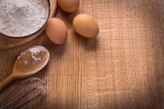 Organized copyspace eggs flour in bowl spoon Royalty Free Stock Photos