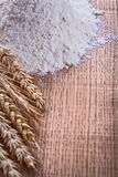 Organized copyspace heap of flour and wheat ears Stock Photo