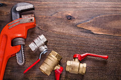 Organized copyspace plumbers fixtures and monkey Stock Image