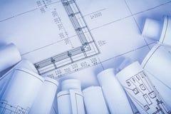 Organized copyspace rolls of blueprints Royalty Free Stock Photos
