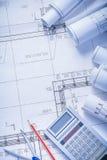 Organized copyspace rolls of blueprints calculator Stock Photo