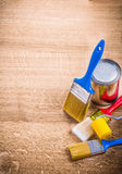 Organized copyspace three paint brushes roller can Royalty Free Stock Photo