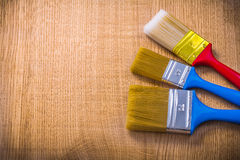 Organized copyspace three paint brushes on wooden Stock Images
