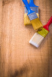 Organized copyspace three paintbrushes on wooden Stock Images