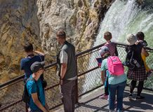 YELLOWSTONE NATIONAL PARK, WYOMING, USA - JULY 17, 2017: Organized group of tourists with a guide watching and taking pictures of Stock Photo