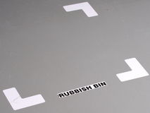 Organized industrial floor with tape markings and label for position of a rubbish bin Stock Images