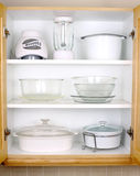 Organized kitchen cupboard Stock Images
