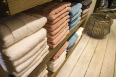 Organized spa towels on wooden shelf royalty free stock photos