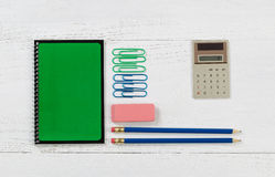 Organized supplies for work or school on white desktop Royalty Free Stock Images