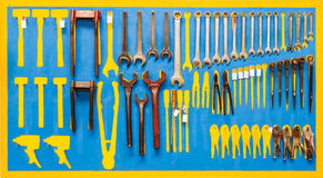 Organized tools on wall Stock Images