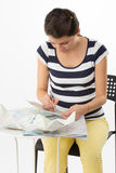 Organized woman planning a journey Royalty Free Stock Images