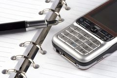 Organizer. With fountain pen and mobile phone Stock Image